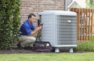 HVAC technician servicing air conditioner outside